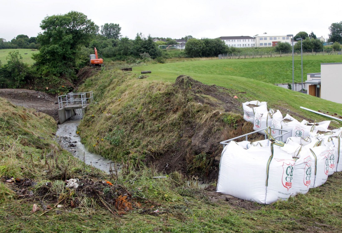 Sandbags in preparation of further heavy rainfall at the stream above the hospital. Photo: Donna McBride