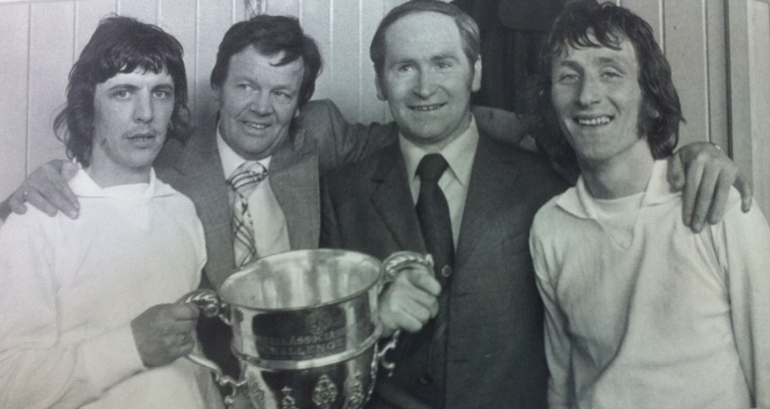 Players Paddy McGrory (left) and Charlie Ferry (right) celebrate with Finn Harps chairman Fran Fields and manager Patsy McGowan.