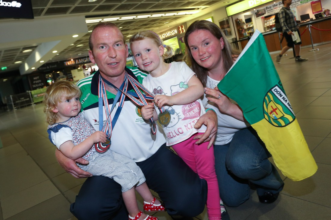 Three times Gold medal winner, Ramelton man Kieran Murray, pictured with  his family at Dublin airport at the weekend when he and other members of Transplant Team Ireland returned from the 8th European Transplant and Dialysis Championships in Krakow, Poland.